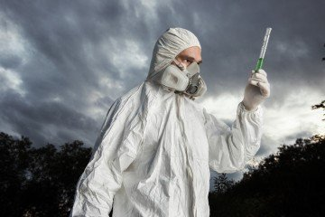 Scientist wearing a protective suit