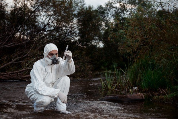 scientist taking a sample of contaminated water