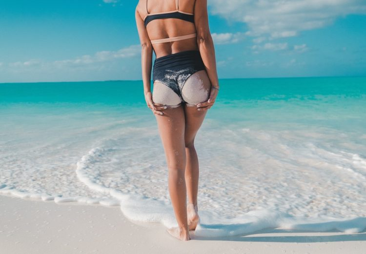 woman on beach showing sexy butt