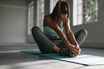 woman stretching hip flexors