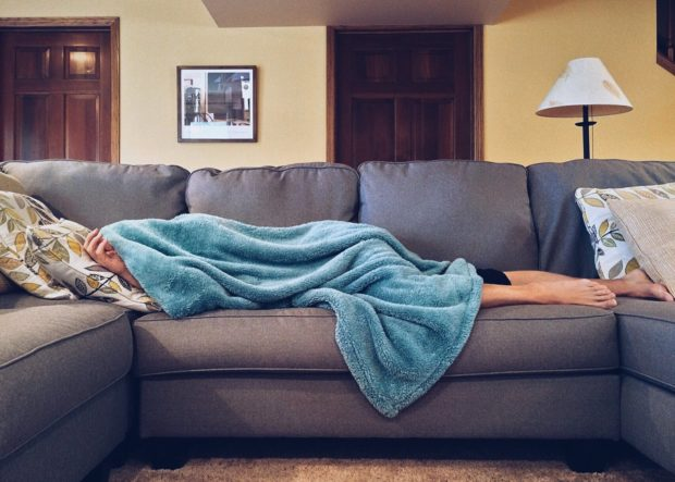 person lying on couch