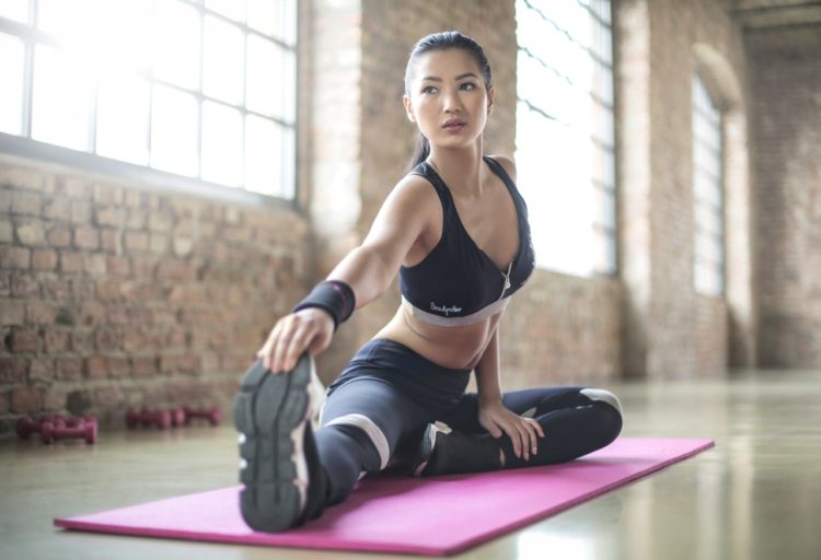 woman yoga stretch on mat
