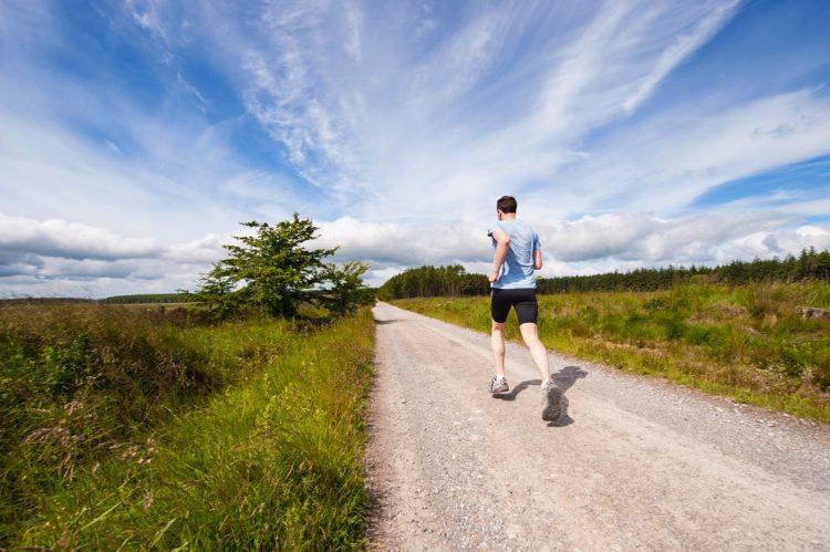 man running on nature trail