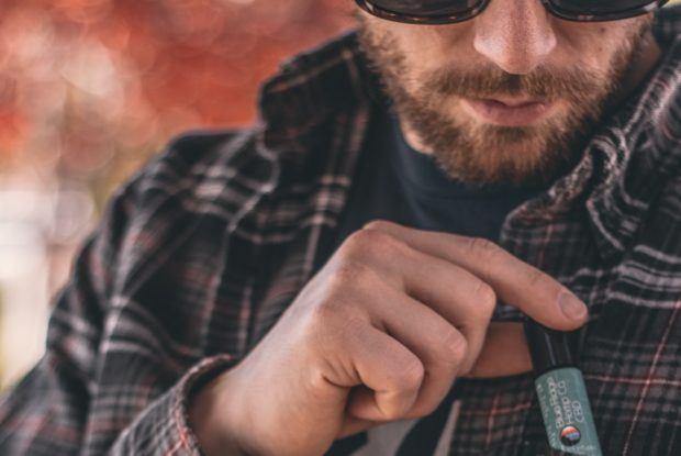 man with cbd oil in shirt pocket