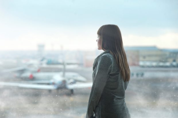 woman looking at airplanes at airport